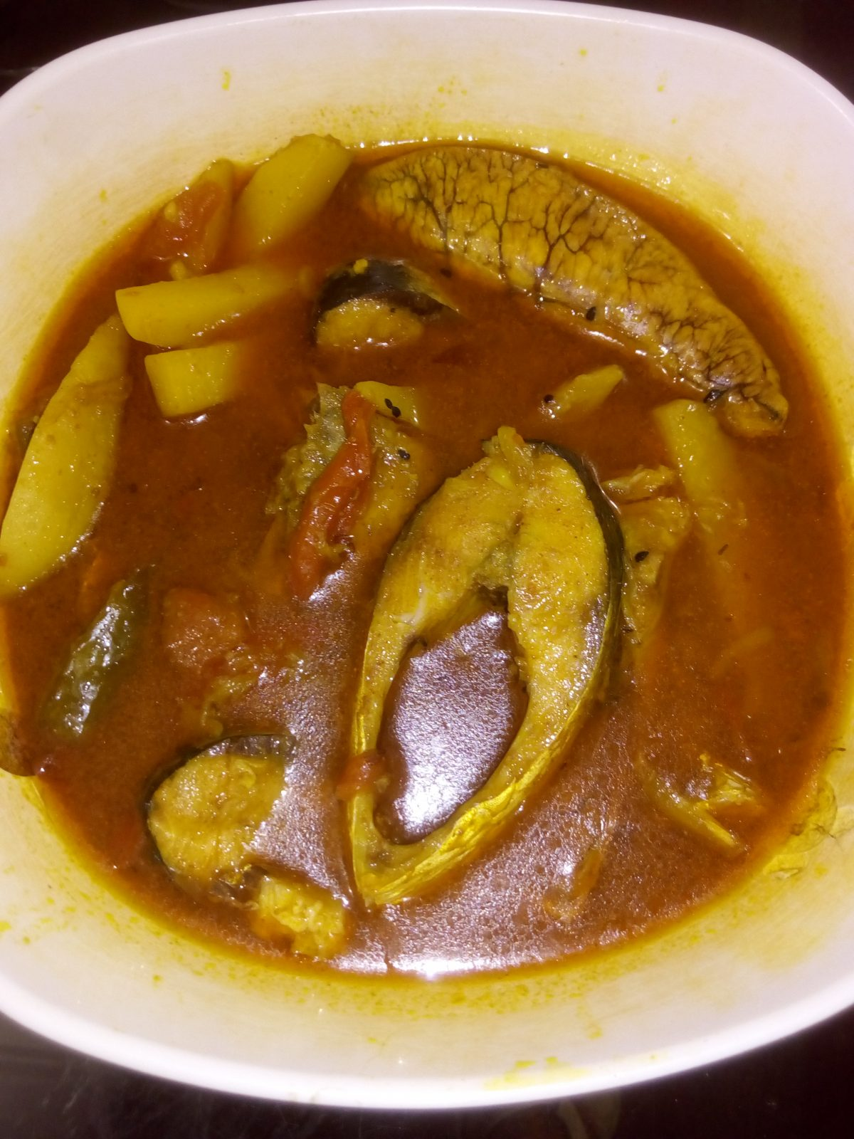 Tomato alu dia illish jhol from Ayesha's Kitchen