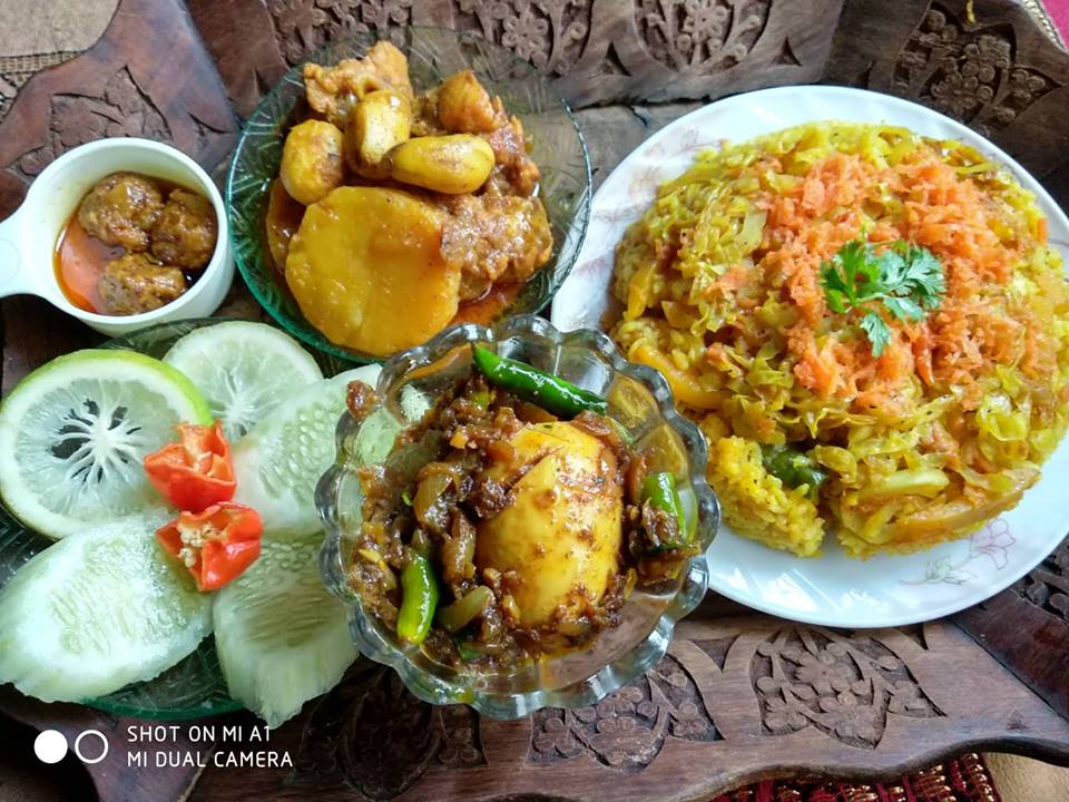 Vegetable Khichuri, Chicken Curry, Dim Bhuna, Achar and Salad from Porin's Kitchen