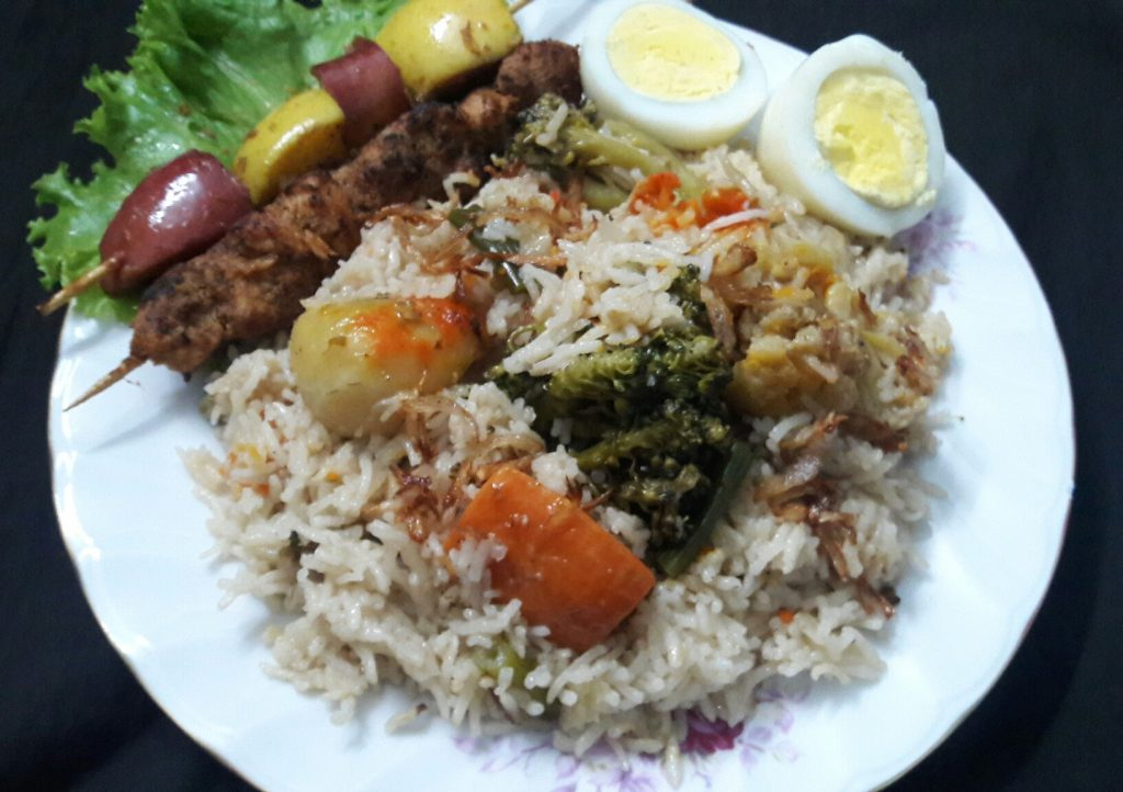 Vegetable Biriyani with Boneless Chicken Tikka,Fruit Kebab and Boiled Egg(for 2 person) from Parijat Homefood
